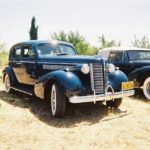 Paul Borgwardt and Connie Ely '38 Buick Century Touring Sedan