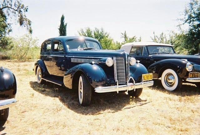 Paul Borgwardt and Connie Ely '38 Buick Century Touring Sedan